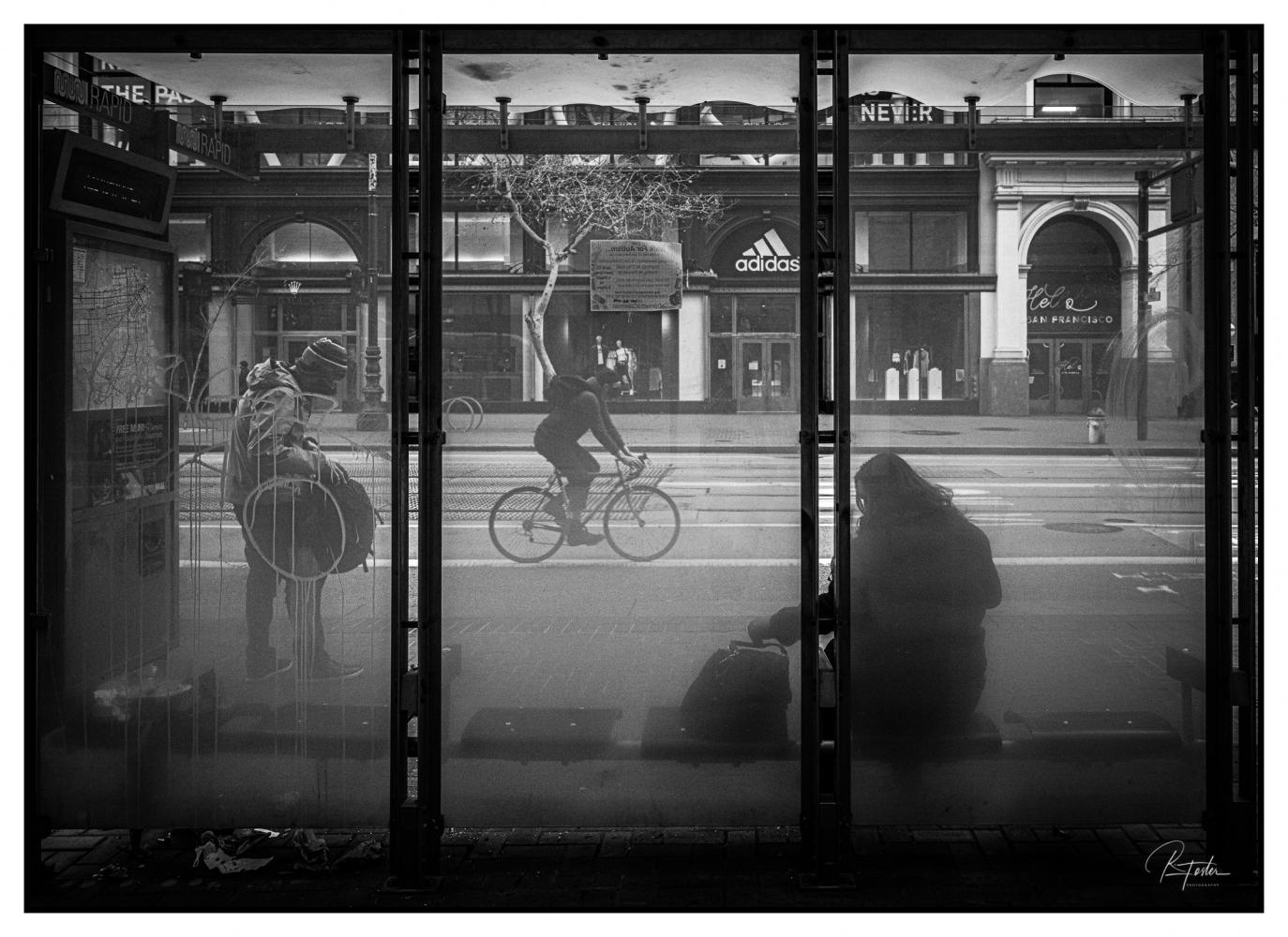 Life thru Bus Stop Glass, ©2021 Reginald Foster